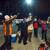 High Five: The United Way volunteers come together for a 'high five' after coming down from the roof of Baesler's Market Friday evening.