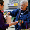 Tribune-Star/Joseph C. Garza<br /> Filling the bucket: Therese Gropp makes a donation to the United Way Friday at Baesler's Market as part of the United Day for the United Way.