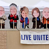 Tribune-Star/Joseph C. Garza<br /> Big-headed about fundraising: Rick Burger, Gary Morris, Tim Sturgess, Bernice Helman, Marla Flowers and United Way Executive Director Troy Fears manned the roof of Baesler's Market Friday for the United Day for the United Way.