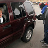 "Tribune-Star/Joseph C. Garza<br /> Kidding ""The Kidd"": Connie Huff jokes with her grandson, 100.7 MIX FM's Jimmie Kidd, as he pumps her gas as part of United Day for the United Way Friday at Baesler's Market."