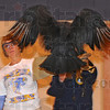 """Tribune-Star/Jim Avelis<br /> Roadkill: Franklin Elementary school principal Tina Horrall provides a perch for """"Buzz"""" the black vulture that is part of the Birds of Prey program brought to area school by Duke Energy."""