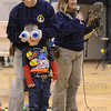 Tribune-Star/Jim Avelis<br /> Seeing is believing: Cindy Maynard of the American Eagle Foundation, based in Pigeon Forge TN, demonstrates the relative size of an owl's eyes with help from a pair of softballs. Modeling the eyes is Franklin Elementary School kindergarten student Raiden Griffin. With Maynard of Karen Wilbur, holding a barred owl.