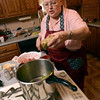 Tribune-Star/Joseph C. Garza<br /> Into the cooker you go: Helen Anderson places a freshly rolled cabbage roll into her pressure cooker as she makes about a half dozen of the traditional New Year's specialties Dec. 26 at her home in north Terre Haute.