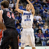 Tribune-Star/Joseph C. Garza<br /> Shooter!: Indiana State's Jake Odum shoots one of his three-point baskets over the Bradley defense during the Sycamores' 77-66 win Saturday at Hulman Center.