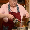 Tribune-Star/Joseph C. Garza<br /> The last step: With her cabbage rolls in the pressure cooker, Helen Anderson pours tomato sauce with brown sugar and cider vinegar over them to complete the recipe.