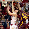 By a finger: Minnesota's Ralph Sampson, III, blocks a scoring attempt by Indiana's Cody Zeller during the Gophers' win Thursday in Bloomington.