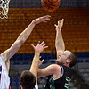 Baby hook: West Vigo's Cody Thornton throws up a shot during first half action Saturday night at Hulman Center against the Linton Miners.