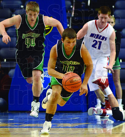 Push it: West Vigo's #10, Kyle Stewart pushes the ball upcourt during first half action against the Linton Miners.