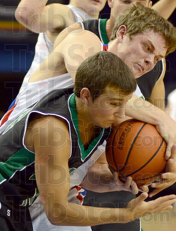 Ball battle: West Vigo's #10, Kyle Stewart gets into a ball battle with a Linton player during first half action at Hulman Center Saturday evening.