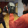 Tribune-Star/Jim Avelis<br /> Punching it up: Padma Panugoti works out at Ultimate Fitness last Wednesday with Argie Gonzales. Her routines includes both light and heavy gloves as well as stretching and aerobic fitness.