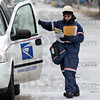 Tribune-Star/Jim Avelis<br /> Cool running: Letter carrier Susanna Patrick exits her van on Terre haute's southside Saturday morning. Using strap on cleats to help her keep her footing, she went about her appointed rounds.
