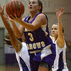Split decision: Sullivan's Caelan Jones splits the defense of Clay City;s Carmela Roeschlein and Abby Reed for a layup.