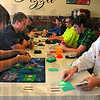 Tribune-Star/Jim Avelis<br /> Let the games begin: Derek Stroot and Andrew Ramey faced off in the first round of the Pokemon tournament held at Footers' Pizza Saturday morning.