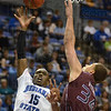 Tribune-Star/Jim Avelis<br /> Matchup: Carl Richard shoots over the defense of Missouri State standout Kyle Weems.