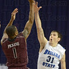 Tribune-Star/Jim Avelis<br /> In your face defense: Missouri State guard Keith Pickens finds R.J. Mahurin in front of him on this first half shot attempt.