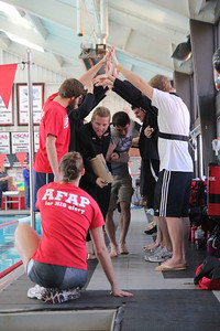 Team celebrates the seniors at the senior swim meet against College of Charleston