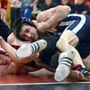 Tribune-Star/Jim Avelis<br /> All tied up: Terre Haute South's Darren Pemberton, wrestling at 120 pounds seeks an escape from North's Eric Elia in the early going of their crosstown match Wednesday night in the Braves' gym.