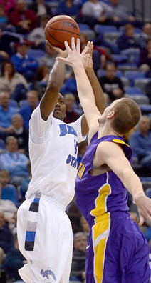 Tribune-Star/Joseph C. Garza<br /> The hot shooter: Indiana State's Carl Richard shoots over a Northern Iowa defender during the Sycamores 59-54 win Wednesday at Hulman Center. Richard led the Sycamores in scoring with 17 points.