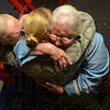 Tribune-Star/Jim Avelis<br /> Family: USAF Major R. Raynae Leslie gets hugs from her parents William and Sandra after she surprised them with an early return from deployment in Afghanistan.