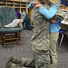 Tribune-Star/Jim Avelis<br /> Alone time: USAF Major R. Raynae Leslie hugs her daughter Lena Leslie Holt after surprising her in her Terre Town Elementary School classroom. The Major returned early from deployment to Afghanistan.