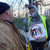 Not mousey: Penny Shepherd, a leader in Painters Local460 in Hobart, talks with a fellow member outside the Indiana statehouse Wednesday morning.
