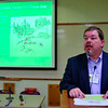"Tribune-Star/Joseph C. Garza<br /> Not so civil war: Tim Phipps reads about the Parke County posse war of 1863 during his presentation, ""Family History in the Civil War Era,"" Monday at the Vigo County Public Library."