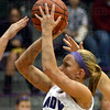 Tribune-Star/Jim Avelis<br /> On target: Brielle Drelick shoots over the Sullivan defense in their matchup last week.
