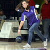 Tribune-Star/Jim Avelis<br /> On a roll: Emily Hazelrigg bowls in late December in high school competition.