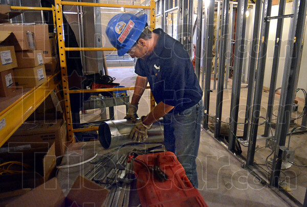Metal man: Sycamore Engineering sheet metal worker Dan Gossman fabricates a fitting during his shift at the Vermillion-Parke Community Health facility Friday afternoon.