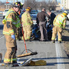 Tribune-Star/Jim Avelis<br /> Two wheeler: Emergency crews clean up after a moped was struck on US41 just south of Johnson Drive.