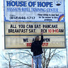 Tribune-Star/Jim Avelis<br /> Ready to serve: Joseph Davis, a resident at the House of Hope puts up a new message on their sign along US 40 in Clay county. The faith based sober living facility has recently re-opened after meeting safety guidelines.