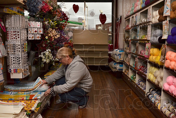 Tribune-Star/Joseph C. Garza<br /> Sewing supplies at the five and dime: Trena Weger looks through material in the aisle that contains sewing supplies Tuesday at Tilford's 5 and 10 near Twelve Points.