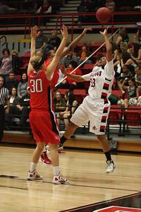 Jasmine Dale, 33, attempts a basket