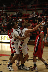 GWU players fight for the ball