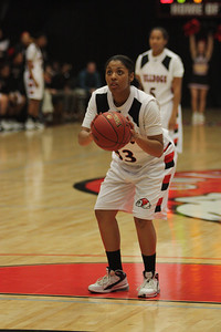 Jasmine Dale, 33, attempts a free throw