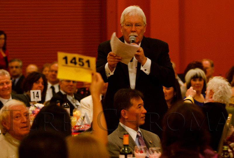 Auctioneer Gary Corbett takes bids on the floor.  The 10th Annual Chinese New Year Gala, benefiting the Nathan Yip Foundation, at Denver Marriott Tech Center in Denver, Colorado, on Saturday, Jan. 28, 2012.<br /> Photo Steve Peterson