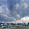 Rain: Cloudy skies greeted race fans at the Vigo County Fairgrounds Thursday night as cars prepare to take the track during an evening of racing.