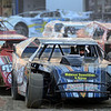Down and dirty: Heat and dust were the order of the evening as drivers sit in their cars waiting to take the track during racing Thursday night.