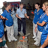 Tribune-Star/Joseph C. Garza<br /> Emergency training: Dorene Hojnicki, center, director of the Vigo County Emergency Management Agency, shares her expertise on emergency medicine with a group of Indiana State University students during a mock disaster drill at the Terre Haute International Airport-Hulman Field Thursday.