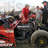 Team talk: Members of the #18 Brett Andrew team discuss the performance of their as they prep for racing Thursday night at the Vigo County Fairgrounds.