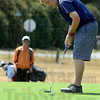 Tribune-Star/Joseph C. Garza<br /> Course concentration: Sam Pollock putts on the eighth hole during the final round of the Terre Haute City Junior Golf Tournament Thursday at Rea Park.