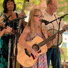 "Tribune-Star/Joseph C. Garza<br /> Sweet melody: Morgan Rayhel, 10, of Marshall, Ill., sings ""Cowboy Sweetheart"" for the crowd at the Terre Foods Blueberry Festival Thursday at Central Presbyterian Church."