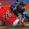 Tribune-Star/Jim Avelis<br /> Safe: Dubois County Bombers base runner Kolin Conner of Indianapolis slides safely into home as Terre Haute Rex Catcher Brian Norwood has the ball slip under his leg.