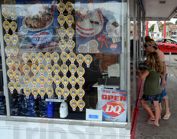 Tribune-Star/Jim Avelis<br /> Helping hand: Donation balloons fill the window of the east side Dairy Queen early Thursday afternoon. DQ  stores are in a partnership with the Children's Miracle Network, raising money for Riley Hospital.
