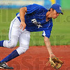 Tribune-Star/Jim Avelis<br /> Scoop: Terre Haute Rex shortstop Spencer Mahoney of LaGrange Park Ill. scoops up a ground ball in the Rex game with the Dubois County Bombers Thursday evening in Terre Haute.