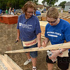 Tribune-Star/Joseph C. Garza<br /> Sign a stud: Darby Scism of the Indiana State University Career Center signs a stud as part of a fundraiser for the Wabash Valley Habitat for Humanity Thursday near the corner of Chase and 23rd Streets. Looking on is fellow volunteer Gloria Martins of the Indiana State Controller's Office.