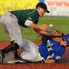 Tribune-Star/Jim Avelis<br /> Safe: Terre Haute Rex base runner Kyle Kempf is safe stealing second base when Danville Dans Drew Hacker can't come up with the ball. Kempf later scored.