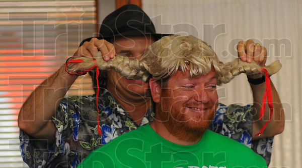 Tribune-Star/Jim Avelis<br /> Billy Bob: The Spoonman recruited members for his bluegrass band including Jason Everetts, seen here complete with braids. The Spoonman gave his presentation Thursday evening in the Marshall Ill. public library.