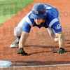 Dirt dive: Rex #6 Kyle Kempf dives back to first base during a pick-off attempt Sunday against the Springfield Sliders. He was safe on the play.