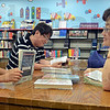 Tribune-Star/Jim Avelis<br /> Family affair: Mia Kim, along with her dad Jung Hwan Kim and mother Sun Yang read in the youth section of the Vigo County Public Library Wednesday afternoon.